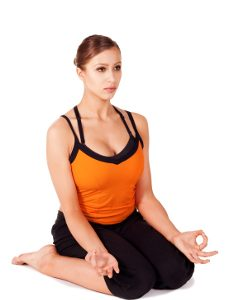 Woman doing thighs stretching yoga posture called Hero Pose, sanskrit name: Virasana, great prenatal exercise, isolated on white